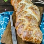 Easy challah bread recipe & tutorial with photos! Anyone can make this delicious, satisfying braided loaf of bread; enriched w/ eggs and topped with sesame seeds. Perfect for dinner, sandwiches, or French toast. Keeps well. See the tutorial on TheMediterraneanDish.com