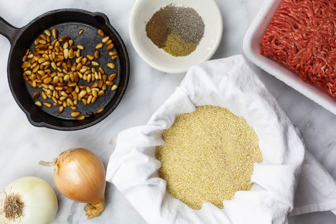 Ingredients of Kibbeh laid out on a table