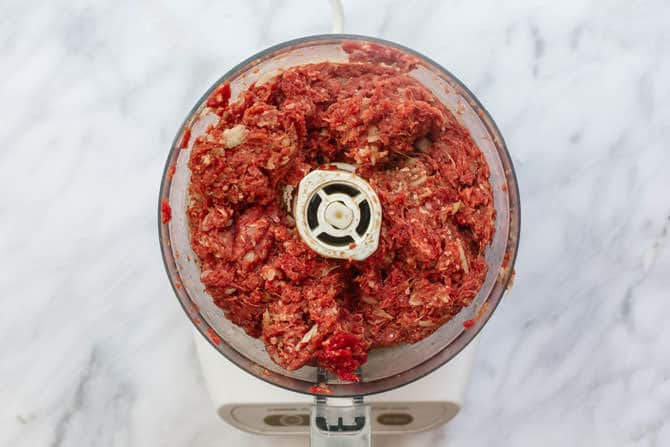Ground meat with spices added to a food processor