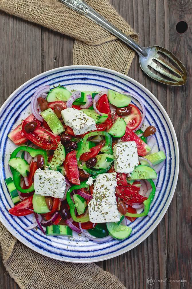 Greek Salad Recipe with serving spoon ready to be served