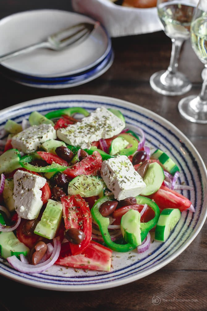 Colorful traditional Greek Salad with chunks of feta cheese and sliced tomatoes