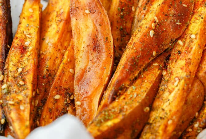 Baked Sweet Potato Fries with Za'atar | The Mediterranean Dish. Easy sweet potato fries recipe that is every bit as healthy, but tastes so indulgent! Wedges of sweet potatoes tossed in olive oil and Mediterranean spices including za'atar. A must try from TheMediterraneanDish.com