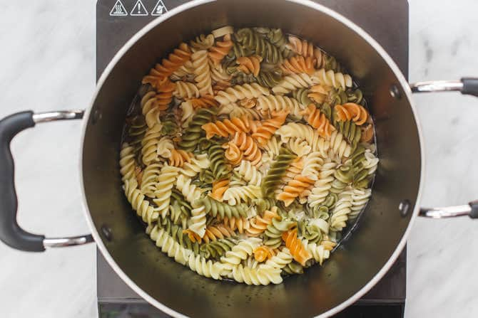 Rotini Pasta being cooked in a pot