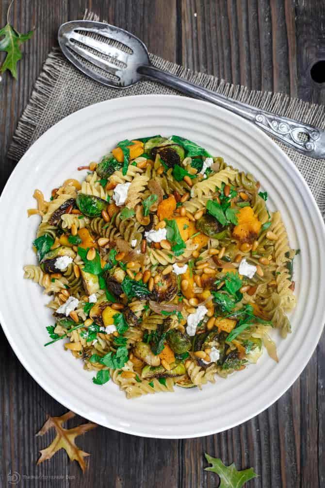 Plate of Rotini Pasta garnished with goat cheese