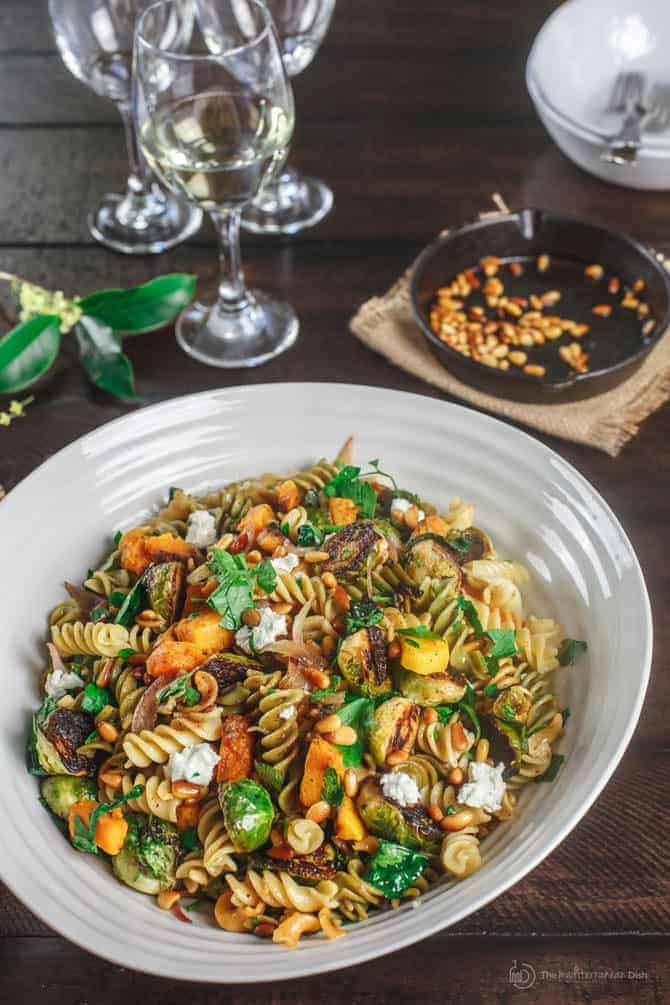 Fall Rotini Pasta with mixed vegetables serve with a glass of wine