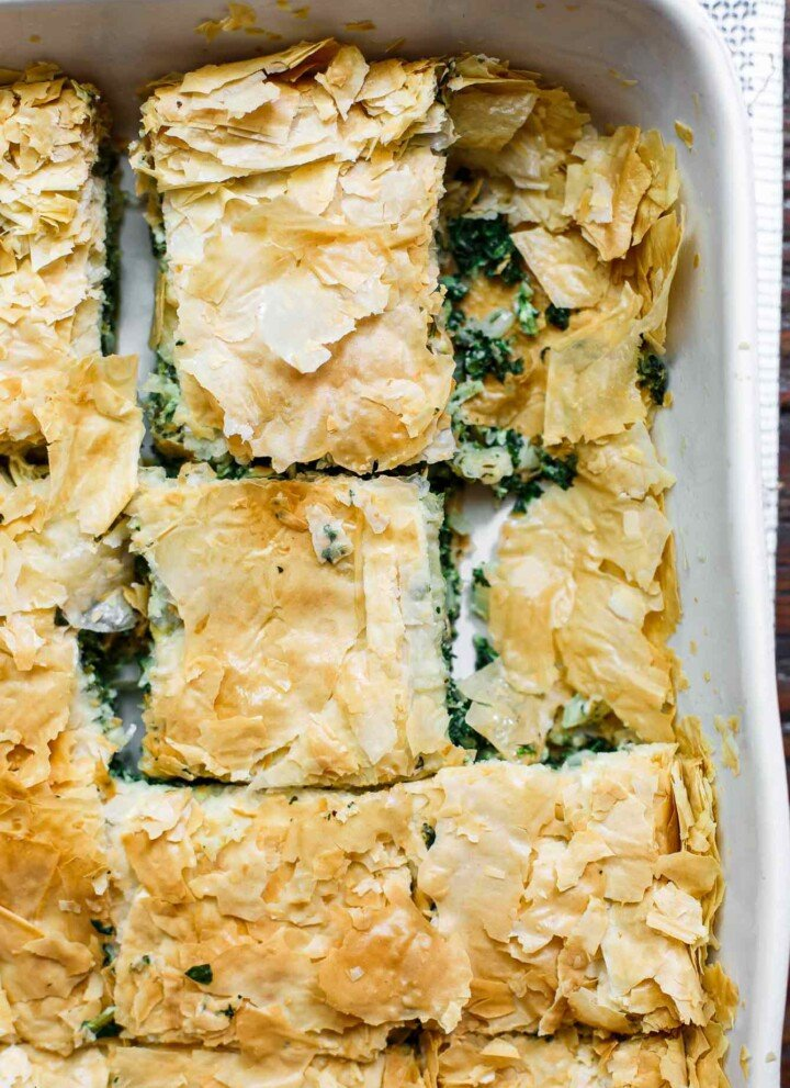 Spanakopita served in a baking dish
