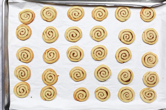 Slices of dough placed on baking sheet in rows