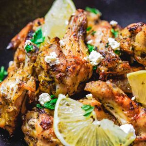 Greek Chicken Wings Recipe | The Mediterranean Dish. These chicken wings are the BEST! Easy, flavor-packed baked chicken wings that have been marinated Greek-style with olive oil, lemon juice, garlic and more! Get the recipe on TheMediterraneanDish.com