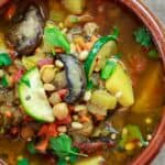 "Mediterranean Homemade Vegetable Soup | The Mediterranean Dish. An easy homemade vegetable soup prepared Mediterranean-style. Quality vegetables, mushrooms, and chickpeas, bone broth with a dose of aromatics, fresh herbs, and bold Mediterranean spices all in one pot! A delicious way to ""detox."""