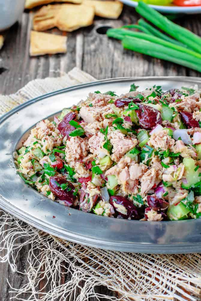 Top Mediterranean Recipe of 2016 | The Mediterranean Dish. Easy Mediterranean Tuna Salad with lots of chopped veggies, olives, and a special Mediterranean dressing! See this recipe and all 10 healthy Mediterranean recipes on TheMediterraneanDish.com