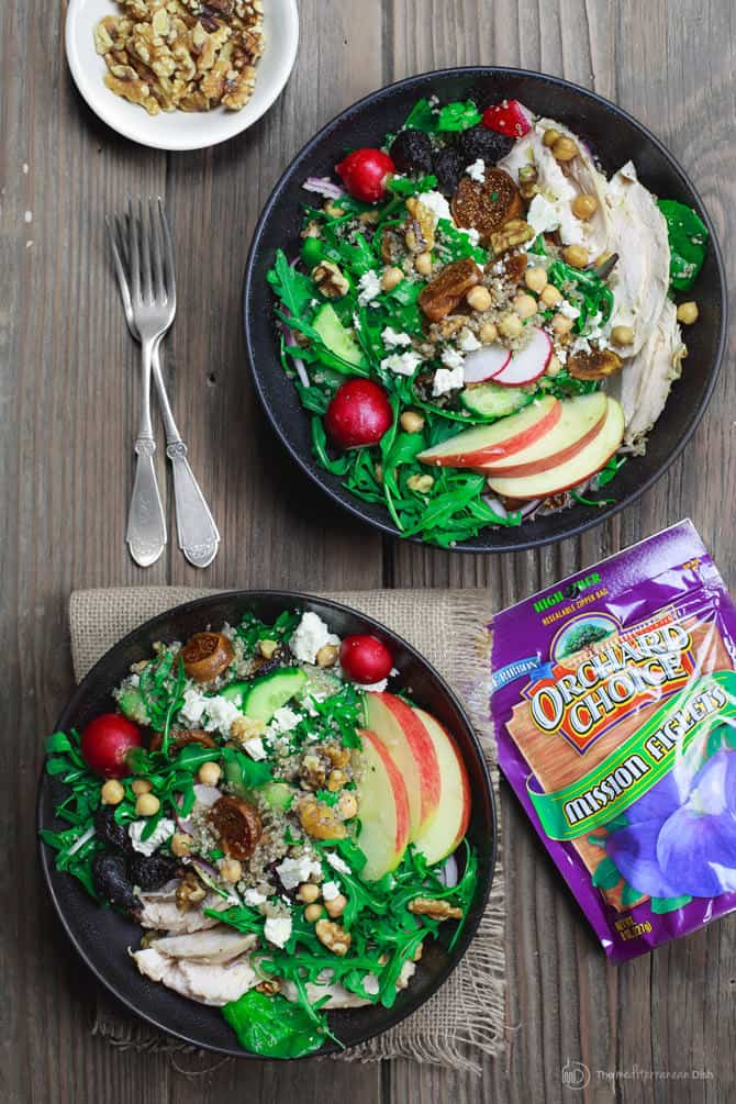 One serving of Chicken Arugula Quinoa Bowl with extra figs and walnuts on the side