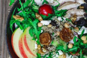Chicken Arugula Quinoa Bowls | The Mediterranean Dish. These loaded quinoa bowls are chock-full of nutrition and delicious Mediterranean flavors. Quinoa with chopped vegetables, leafy greens, chickpeas, chicken, and a good does of walnuts and figs. All of it dressed in a delicious honey vinaigrette. A perfectly delicious way to detox. Get the recipe on TheMediterraneanDish.com