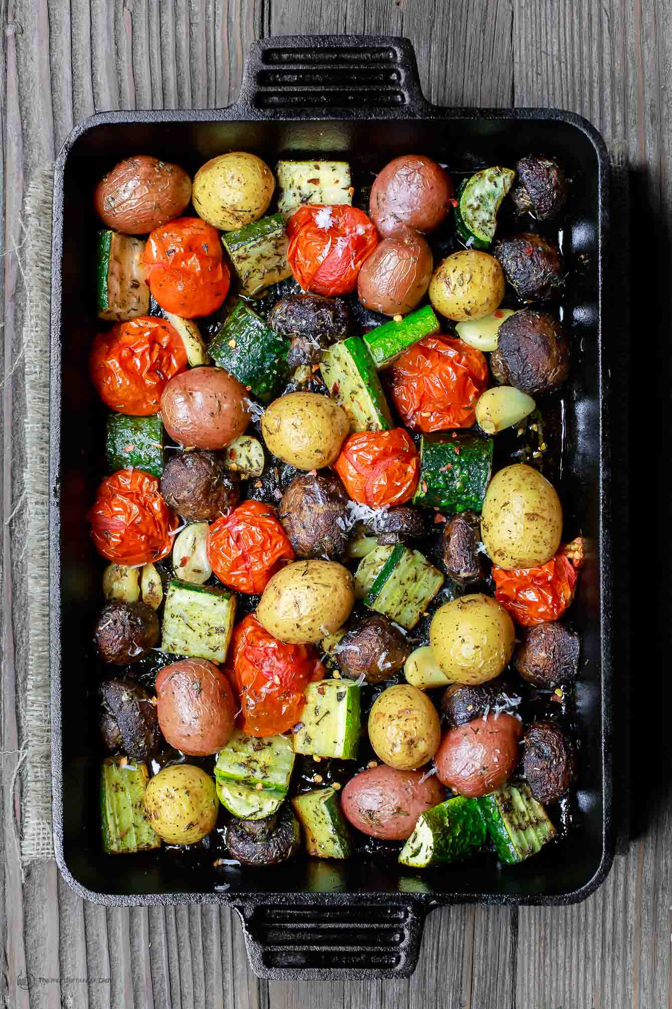 Oven Roasted Vegetables including zucchini, tomatoes, potatoes and mushrooms