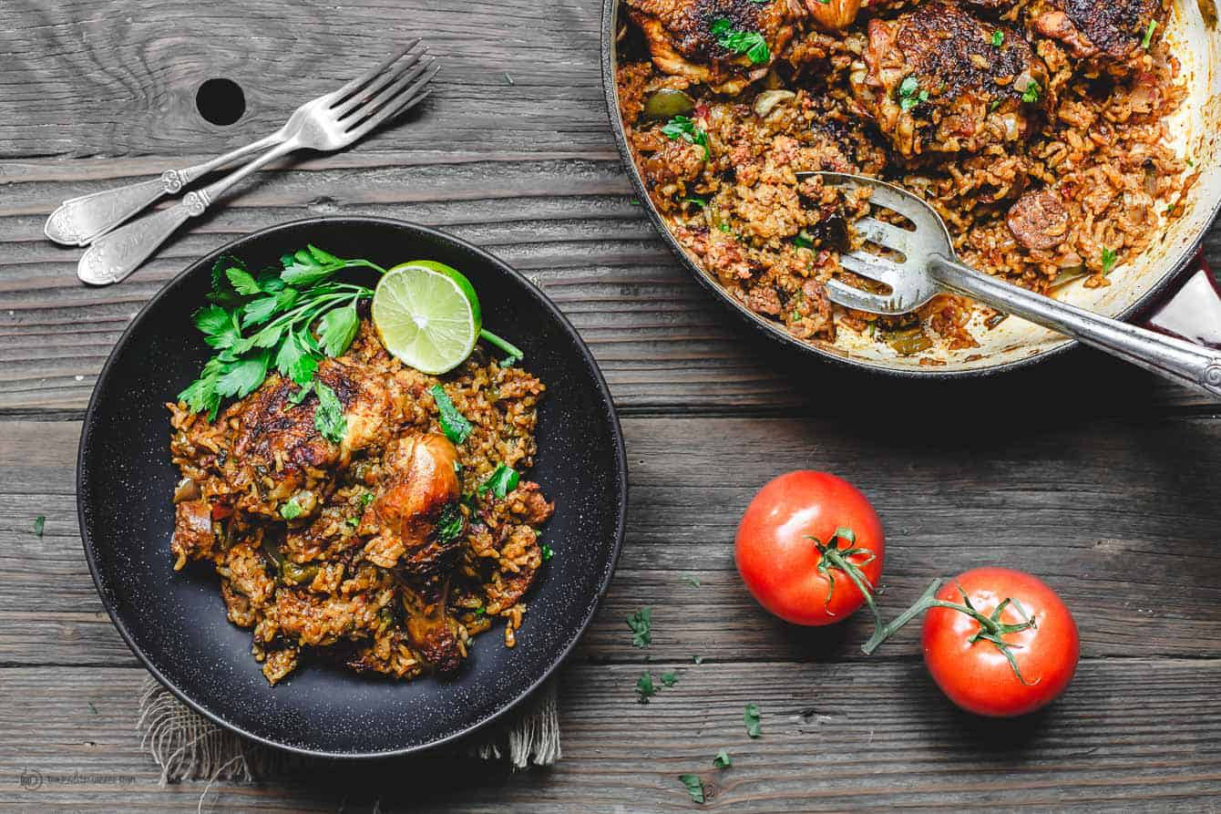 Spanish Chicken and Rice served with tomatoes and fresh parsley