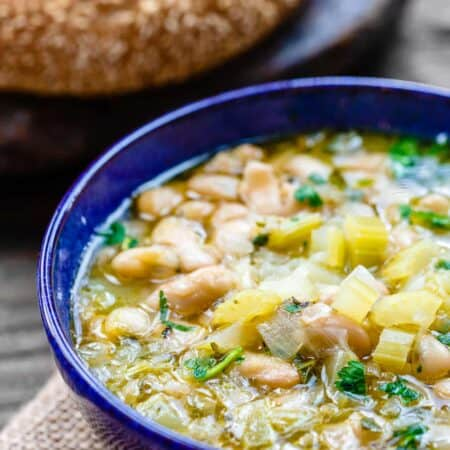 Easy Greek Bean Soup (Fasolada) | The Mediterranean Dish. Simple, flavor-packed Greek soup with white beans, celery, Mediterranean spices and aromatics. A satisfying weeknight dinner for a family on a budget! See the recipe on TheMediterraneanDish.com