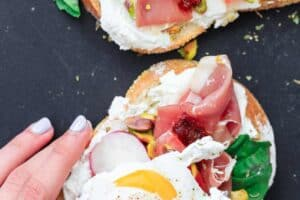 Breakfast Open Faced Sandwich, Italian Style | The Mediterranean Dish. A simple breakfast toast with the flavors of Italy, topped with poached eggs. Brunch just got easier! See the quick recipe on TheMediterraneanDish.com