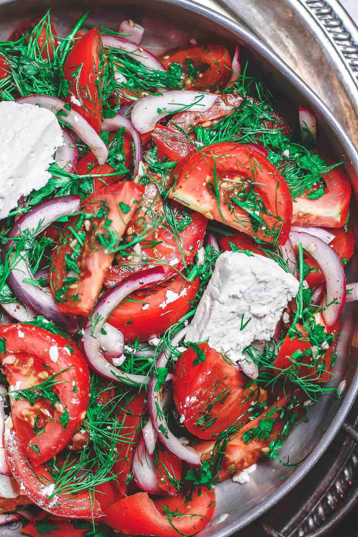 Mediterranean Herb and Tomato Salad. Part of 21 Mediterranean Christmas Brunch Recipes | The Mediterranean Dish. #christmasbrunch #brunch #mediterraneanrecipes
