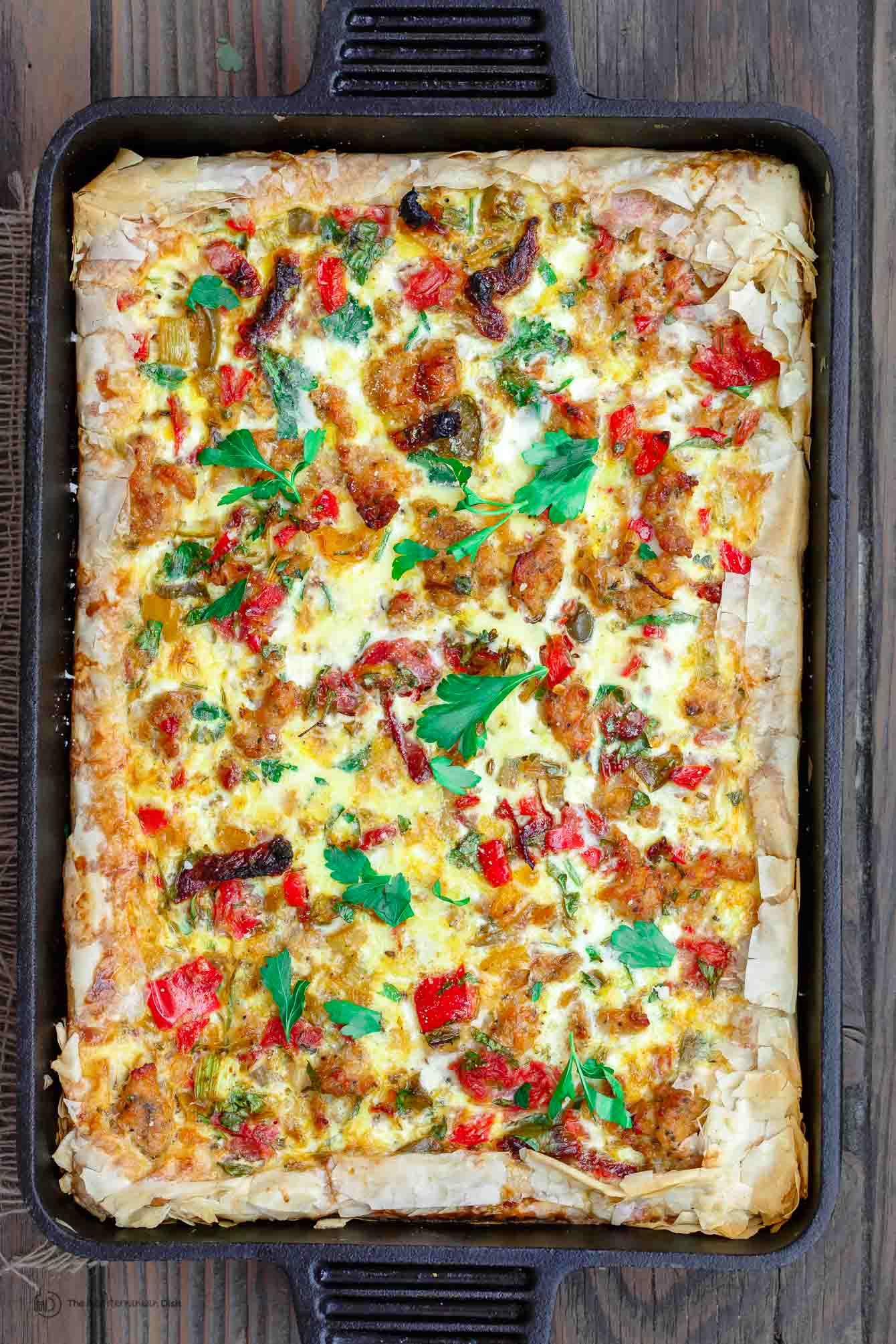 Baked Breakfast Strata ready to be cut and served