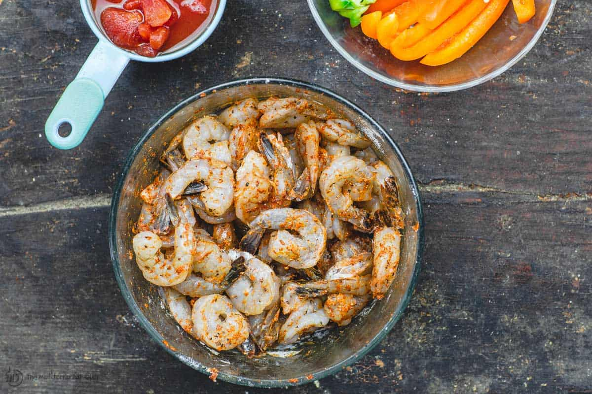 Peeled, deviened shrimp tossed in a little flour and spices to coat
