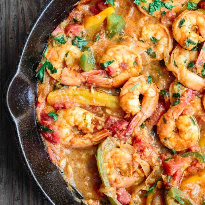 Mediterranean easy shrimp with bell peppers and shallots in skillet