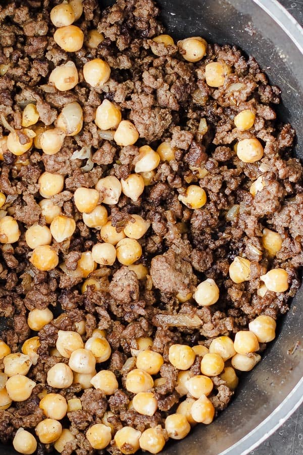 Browned meat with onions, spices, and chickpeas. The first step for making the stuffing for Mediterranean stuffed pepers