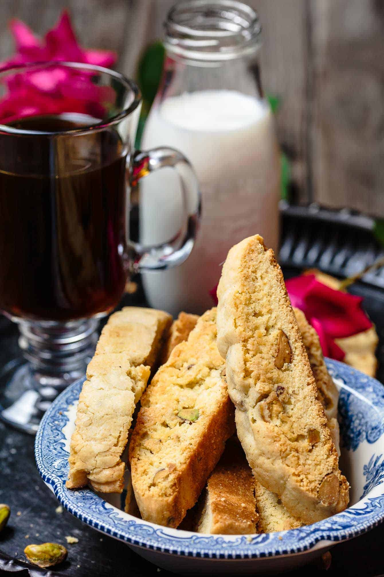Pistachio Biscotti with Coffee and Milk on a Tray