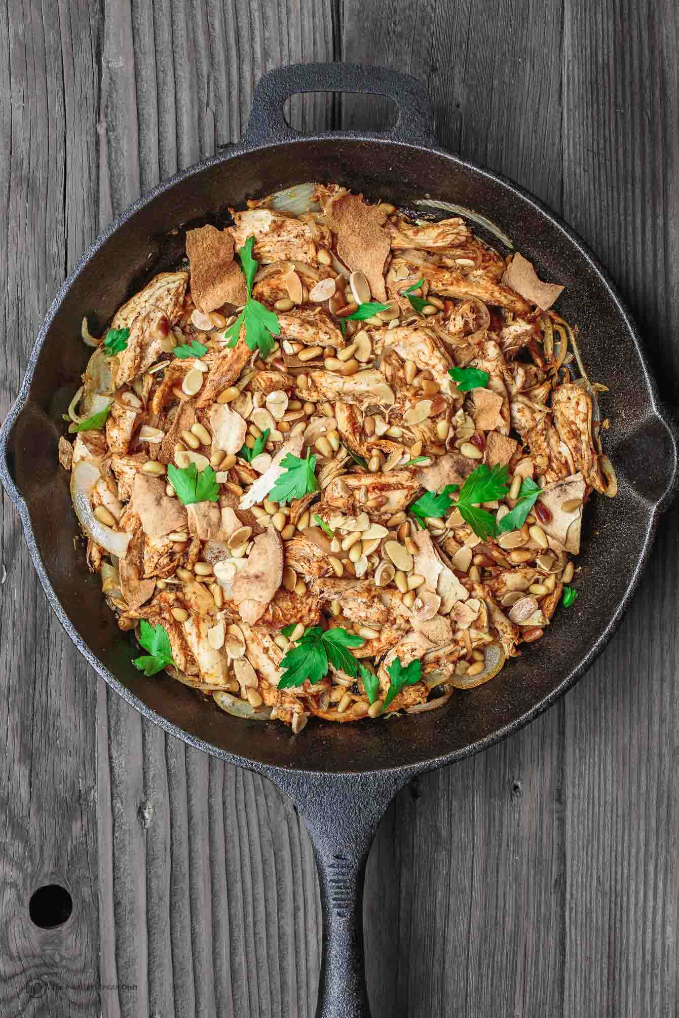 Skillet containing Lebanese Chicken Fatteh