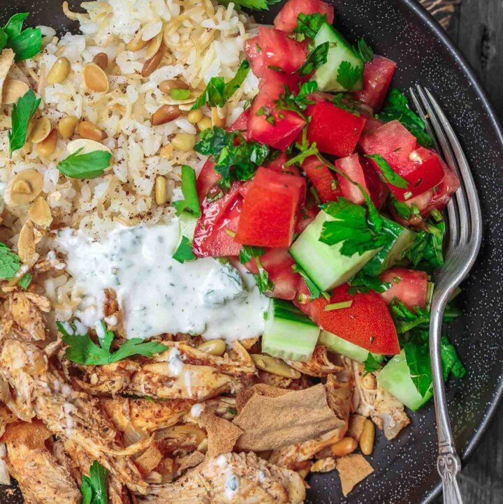 Lebanese Chicken Fatteh Dinner Bowls | The Mediterranean Dish. Flavor-packed Lebanese chicken recipe with toasted pita, rice and a simple Mediterranean salad all in one bowl. Check out the full recipe on TheMediterraneanDish.com