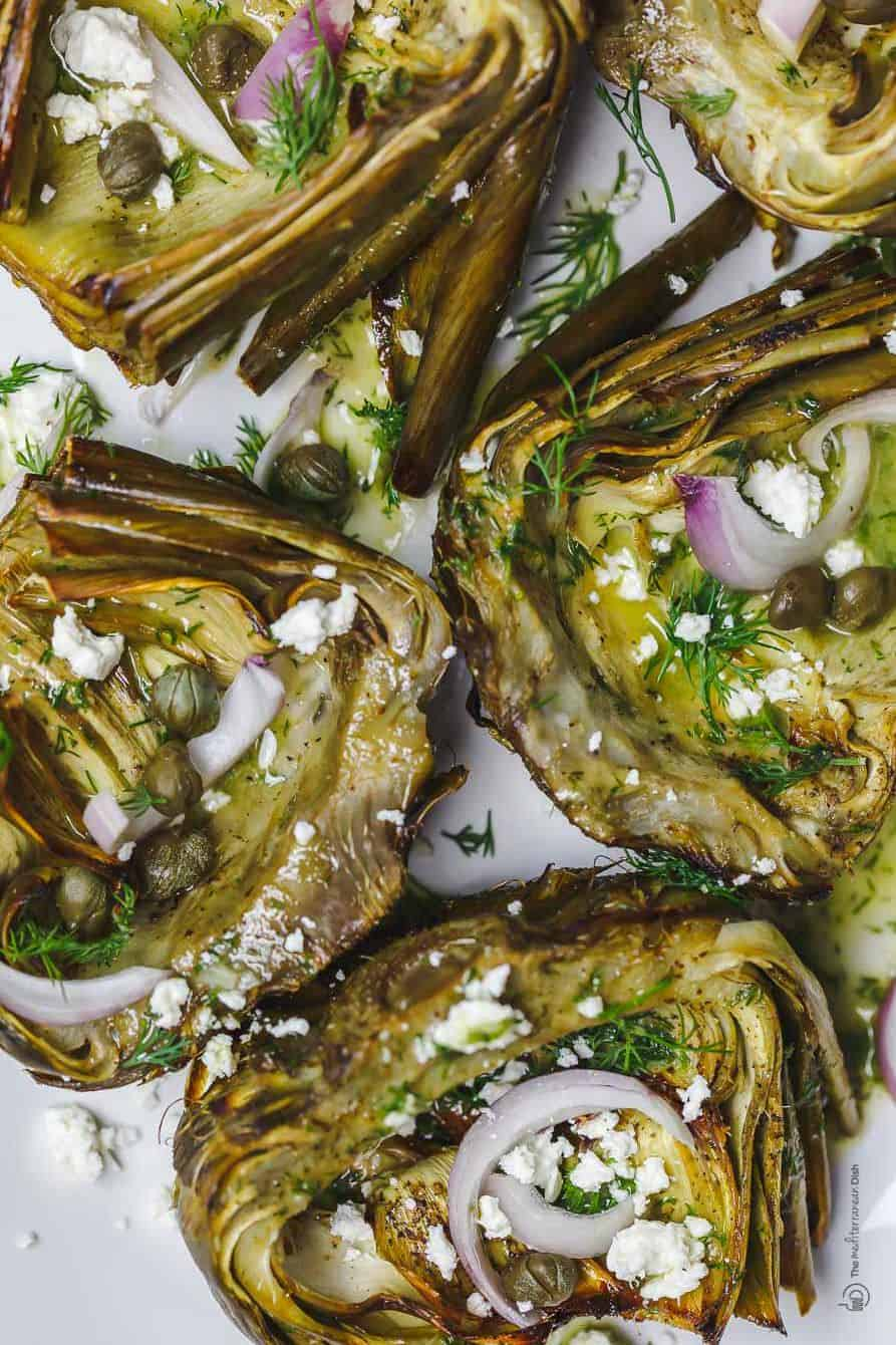 Mediterranean roasted artichoke garnished with capers and roasted garlic-dill vinaigrette.
