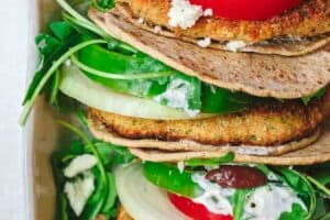 Mediterranean Salmon Burger Recipe | The Mediterranean Dish. Light, moist, flavor-packed salmon burgers with a Mediterranean twist. Recipe comes with great tips to help you make the best homemade salmon burgers. Toppings like homemade tzatziki sauce and a zesty arugula mixture, olives, and feta, make this the perfect Mediterranean diet meal. Low carb. See it on TheMediterraneanDish.com