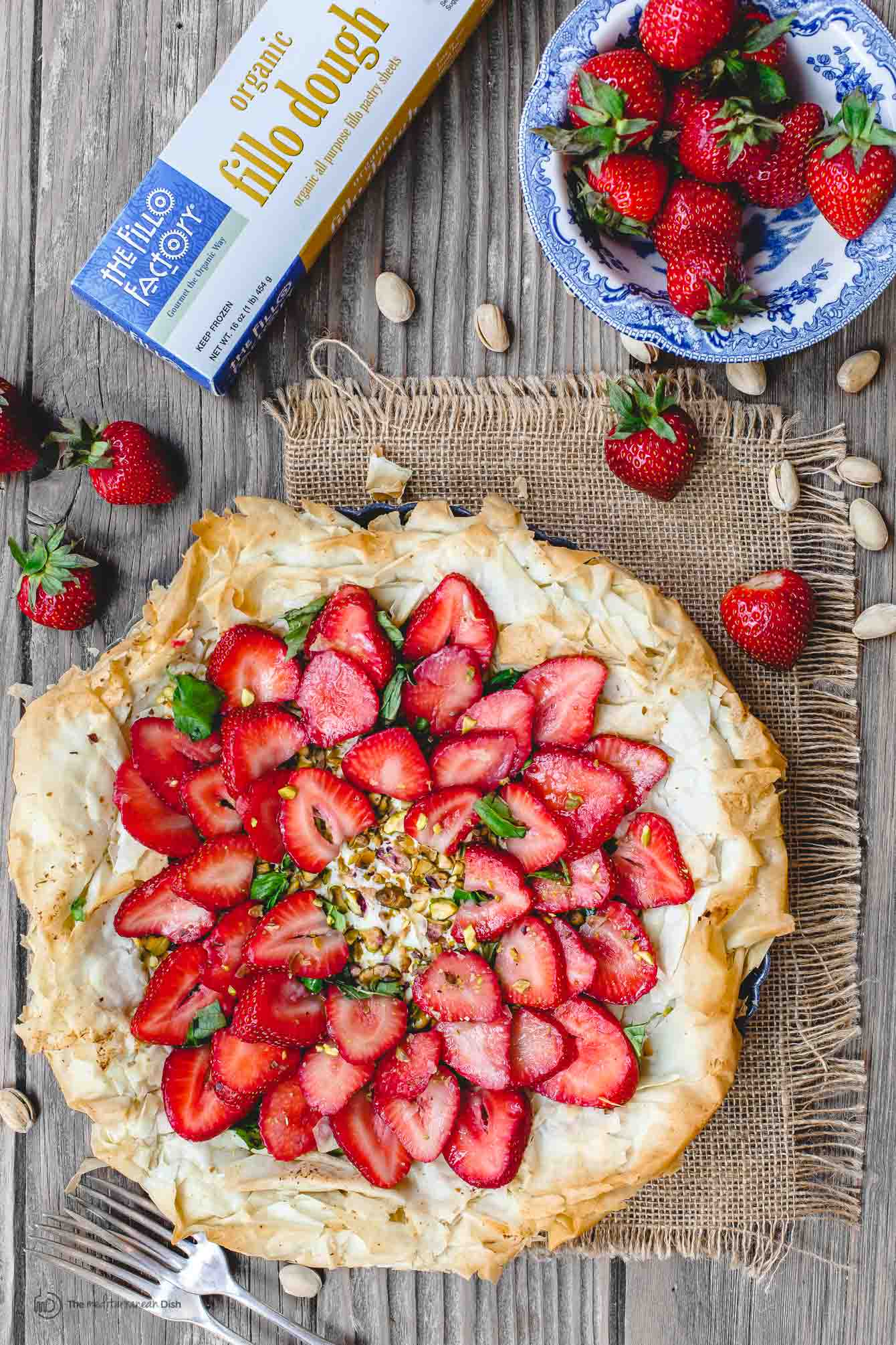Feta Strawberry Tart with bowl of fresh strawberries on the side