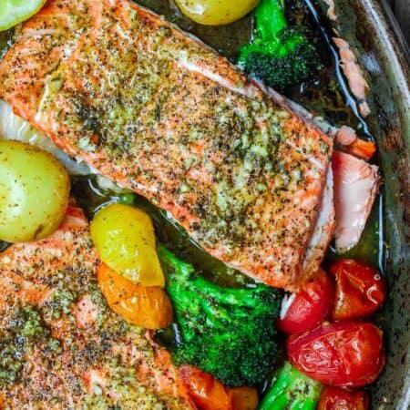 Za'atar Garlic Salmon Recipe | The Mediterranean Dish. Pan sheet garlic salmon with a Mediterranean twist you will love! Crusty za'atar, lemon juice, olive oil and veggies all on one sheet. Ready in 25 minutes! See the recipe on TheMediterraneanDish.com
