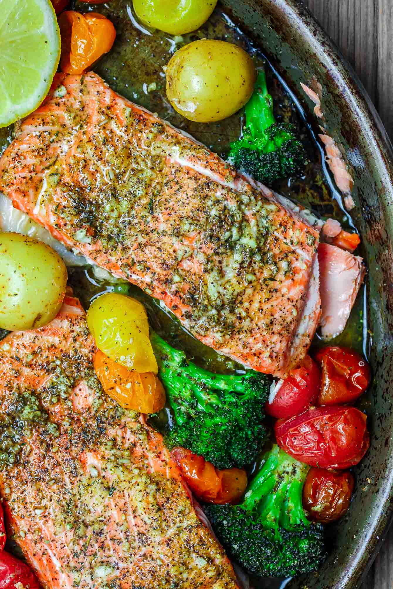 Za'atar salmon with broccoli, grape tomatoes olive oil and lemon wedge
