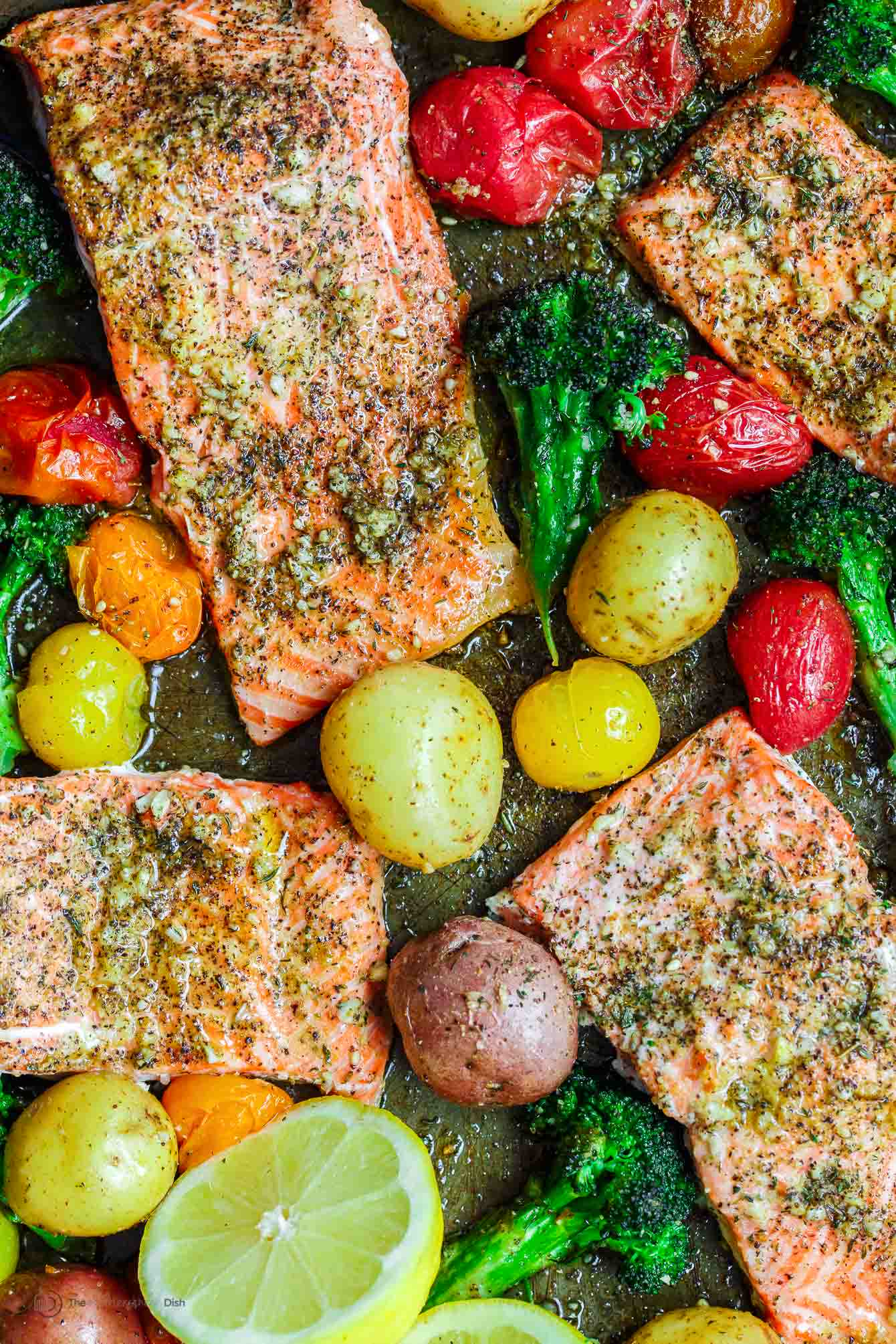 Za'atar garlic salmon in a pan with potatoes, broccoli and colorful grape tomatoes