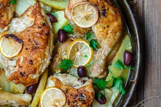 Easy Greek Chicken and Potato Dinner | The Mediterranean Dish. BEST Greek chicken and potato dinner all in one sheet pan! Seasoned with rosemary and baked in a zesty juice with lots of garlic. Definite Winner!