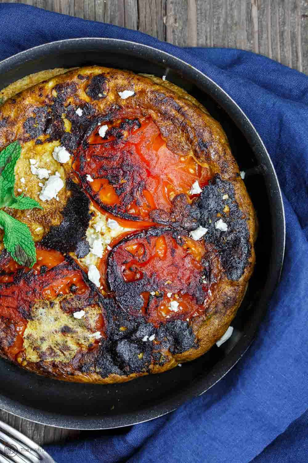 Skillet containing Open-Faced Greek Omelet