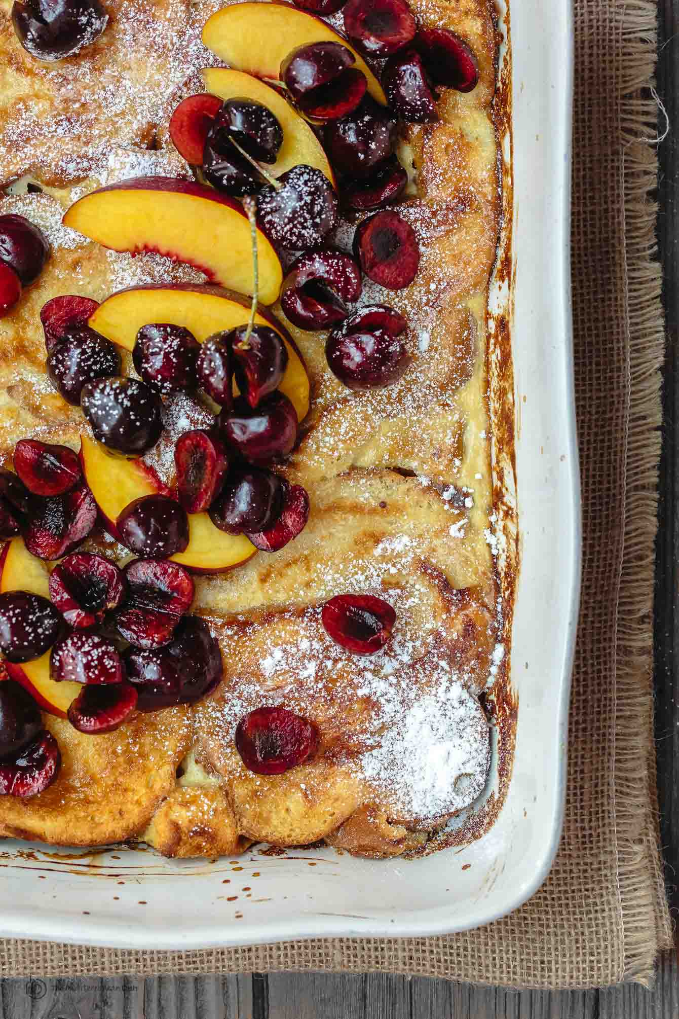 Overnight Baked French Toast Recipe with Challah. Part of 21 Mediterranean Brunch Recipes | The Mediterranean Dish. #christmasbrunch #brunch #mediterraneanrecipes