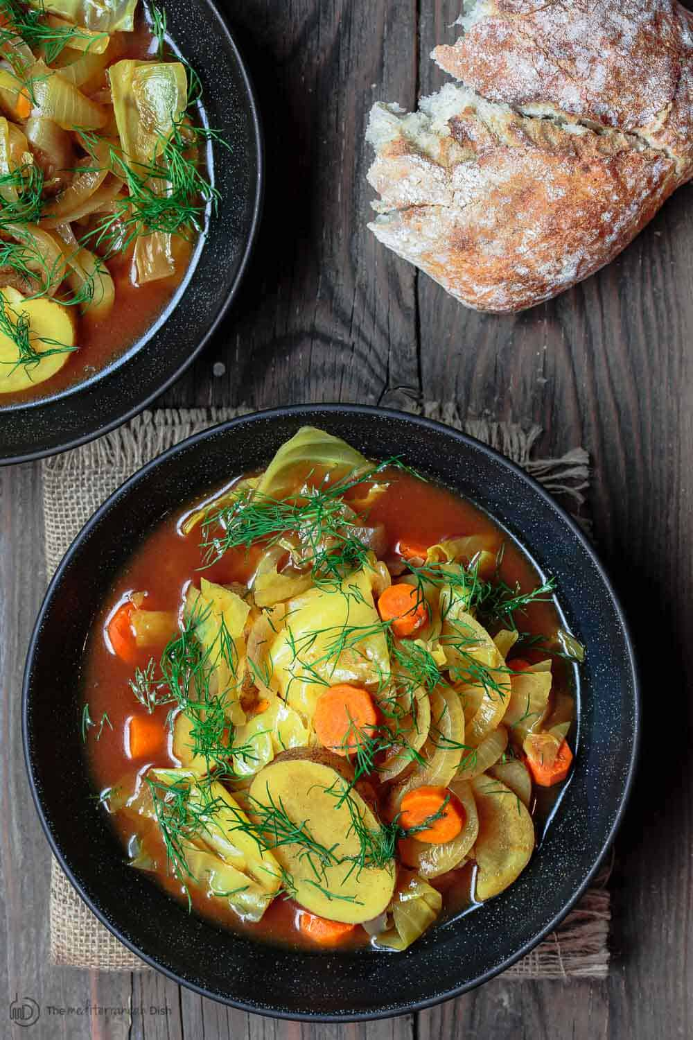 Slow Cooker Cabbage Soup served with bread on the side