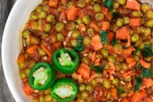Egyptian Vegan Stew with Peas and Carrots | The Mediterranean Dish! A hearty vegan stew with peas and carrots in a tasty aromatic tomato sauce. Great weeknight meal. Comes together in less than 30 minutes! See it on The Mediterranean Dish.com