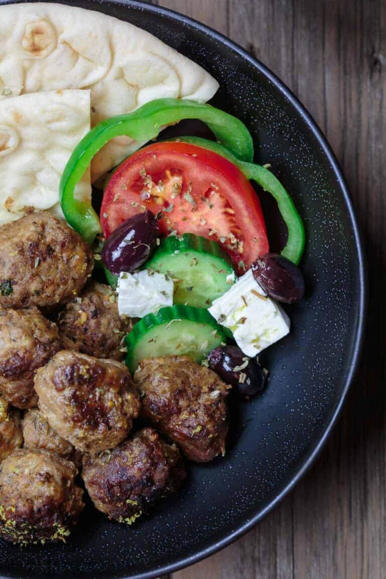 Keftedes Greek Meatballs Recipe | The Mediterranean Dish. Best Greek meatballs ever! Spiced with fresh mint, oregano and more, pan-fried in olive oil then finished with a thick lemony sauce. Serve it with pita and Greek salad and you've got an amazing Greek dinner! See the easy recipe on TheMediterraneanDish.com #greekmeatballs #meatballs #meatballrecipe #greekfood #greekrecipe