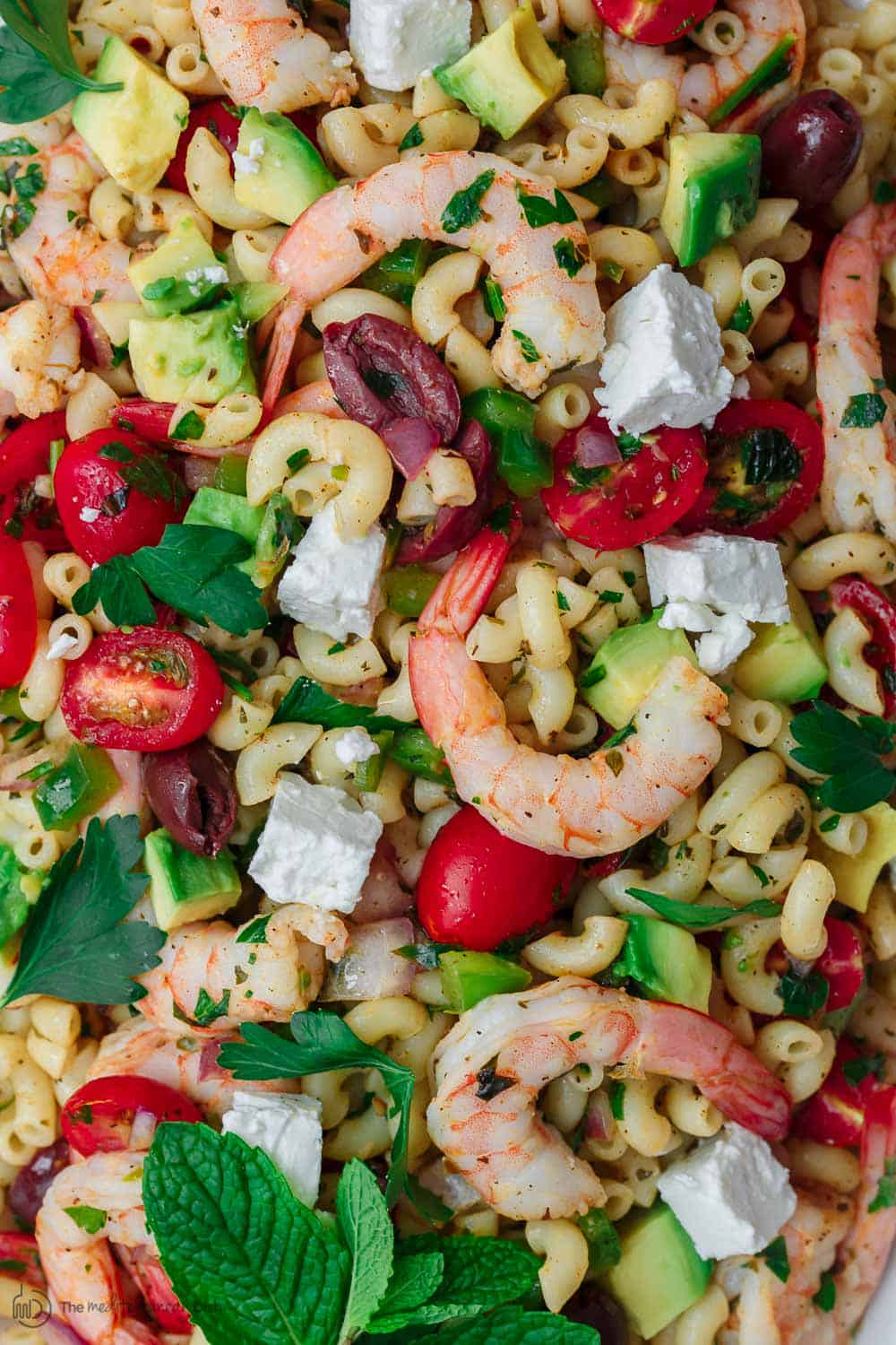 Close-up of shrimp and feta cheese in Mediterranean pasta salad