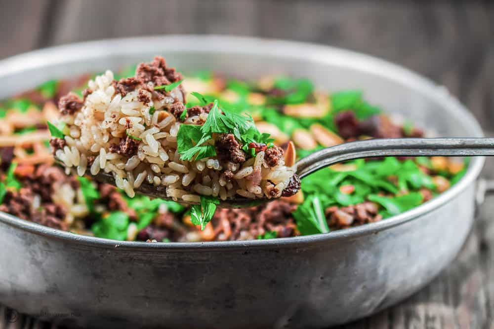 Lebanese Rice (Hashweh) | The Mediterranean Dish. Easy, flavorful loaded Lebanese Rice with ground beef, toasted nuts, raisins and sweet, earthy spices. Makes the perfect side dish or dinner bowl. Think also gluten free stuffing! #rice #lebaneserice #middleeasternrice #lebaneserecipe #mediterraneanrecipe