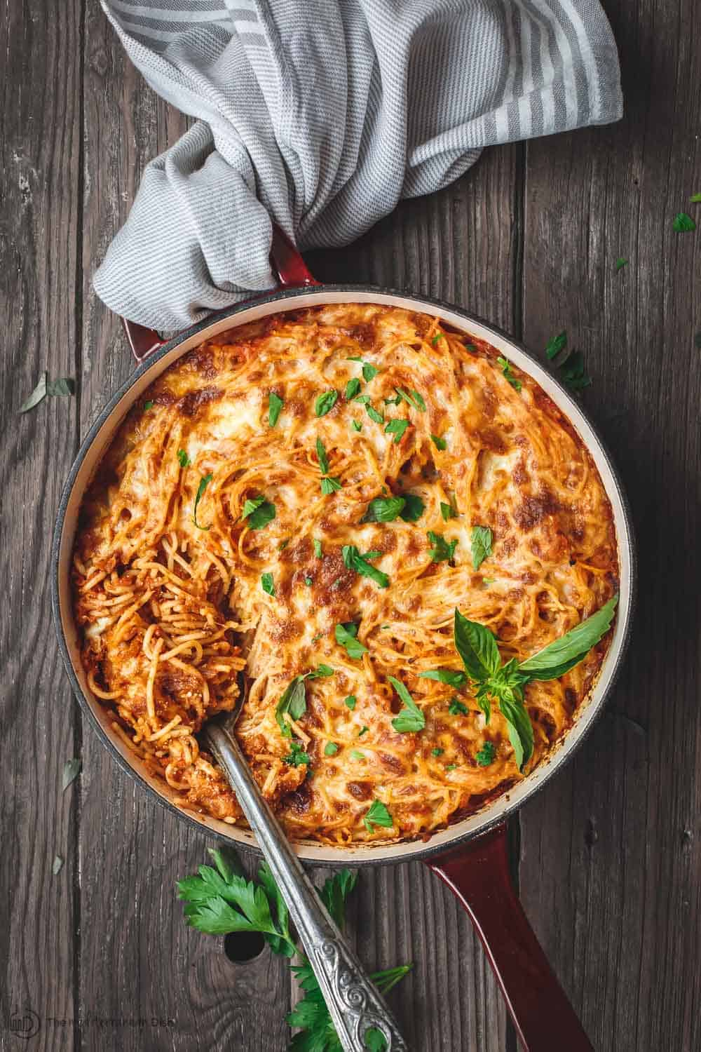 Hearty baked spaghetti in a casserole dish ready to be served.