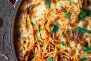Baked Spaghetti Recipe | The Mediterranean Dish! A hearty baked spaghetti casserole with a lighter cheese mixture and the BEST homemade spaghetti sauce. Recipe on TheMediterraneanDish.com #spaghetti #bakedspaghetti #pasta #casserole