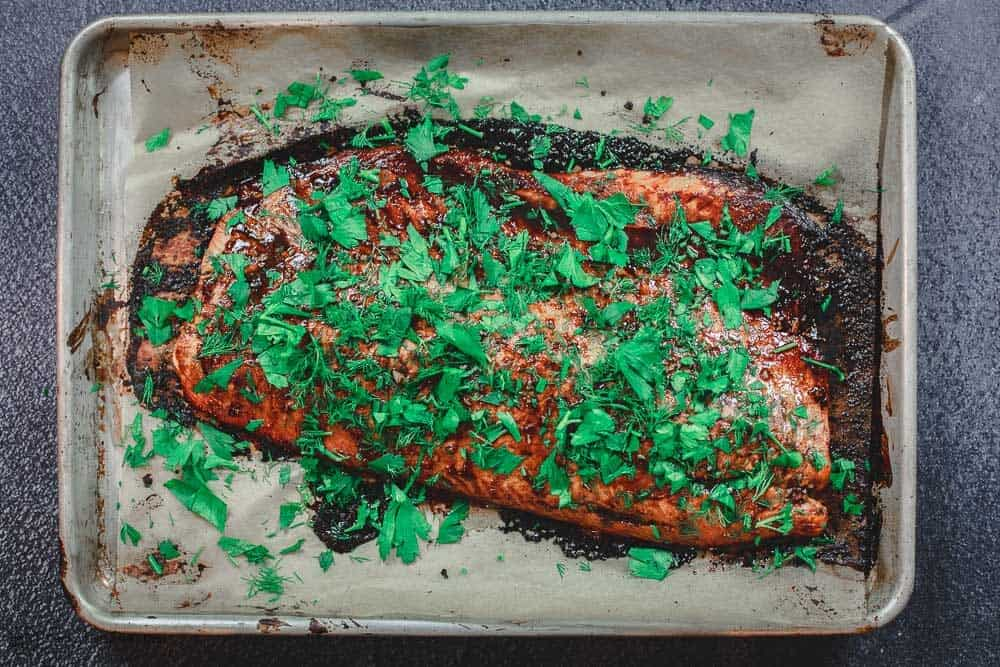 Baking sheet with baked Salmon ready to be served
