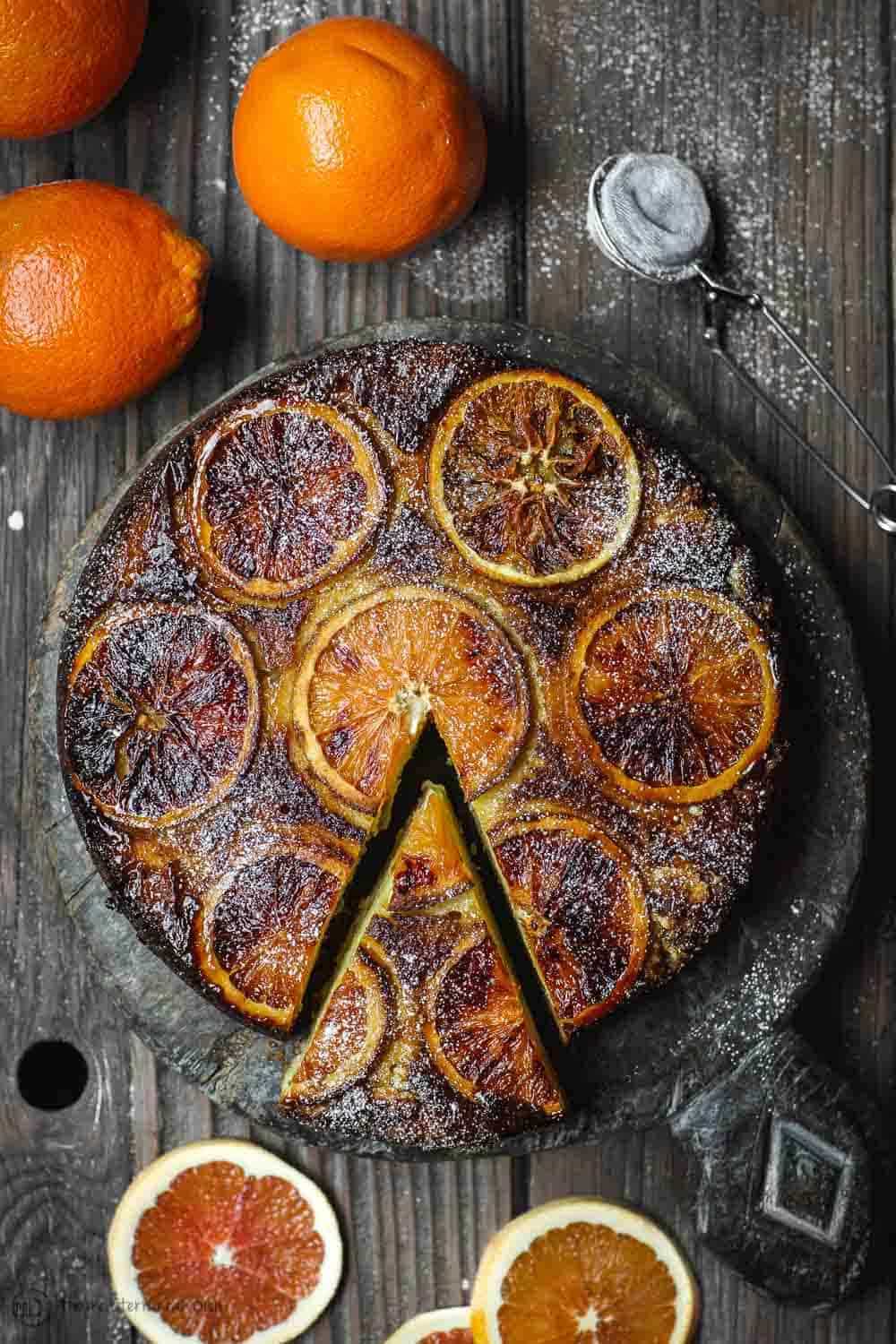Ricotta cake with extra orange slices on the side