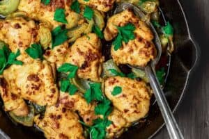 Garlic Dijon Chicken Recipe | The Mediterranean Dish. All-star Dijon chicken recipe. Healthy, gluten free chicken prepared with a light sauce with fresh garlic, Dijon mustard, quality olive oil, honey and warm spices. Bakes in 25 minutes! Recipe comes with suggestions for Mediterranean dishes to serve along! From TheMediterraneanDish.com #chickenrecipes #Mediterraneandiet #healthyrecipes #glutenfree #onepandinner #skilletchicken #skilletrecipes #chickenthighs #chickenthighrecipe