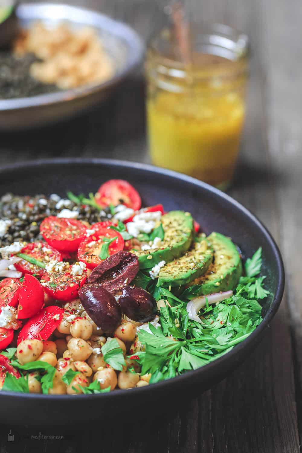 Mediterranean Grain Bowls with lentils, zucchini, avocados, tomatoes and topped with feta cheese.