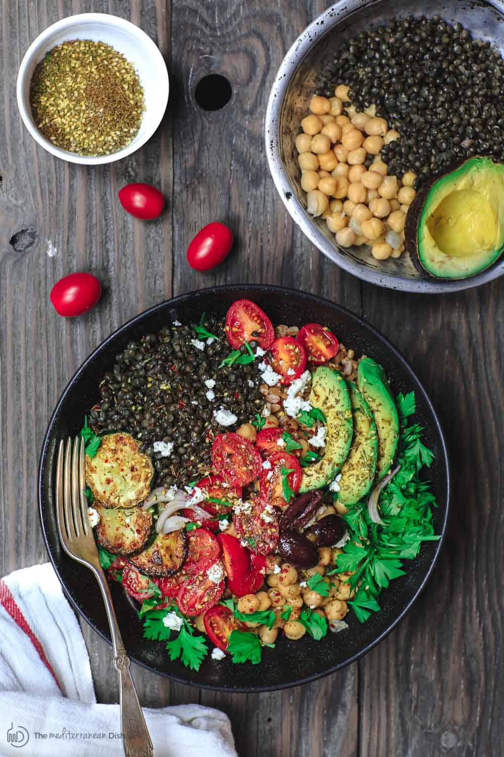 Mediterranean Grain Bowls Recipe | The Mediterranean Dish. Healthy, protein-packed grain bowls with lentils and chickpeas. Packed with Mediterranean flavors. A quick and easy weeknight dinner! From TheMediterraneanDish.com #grainbowls #dinnerbowls #mediterraneandiet #mediterraneanrecipes #chickpearecipes #chickpeas #lentilrecipes #lentil #halfcuphabit #justaddpulses #eatpulses