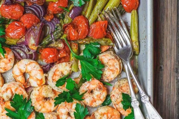 Baked shrimp on a sheet pan served Mediterranean style